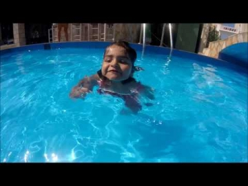3 years old baby jumps in and swims across pool