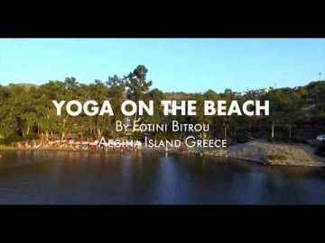 Yoga on Aeginitissa beach in Aegina island Greece